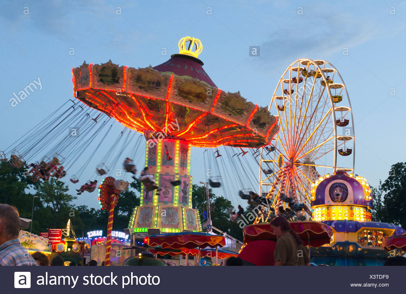 Swing caroussel and Ferris wheel at the Dult fun fair, Landshut, Bavaria, Germany, Europe Stock Photo