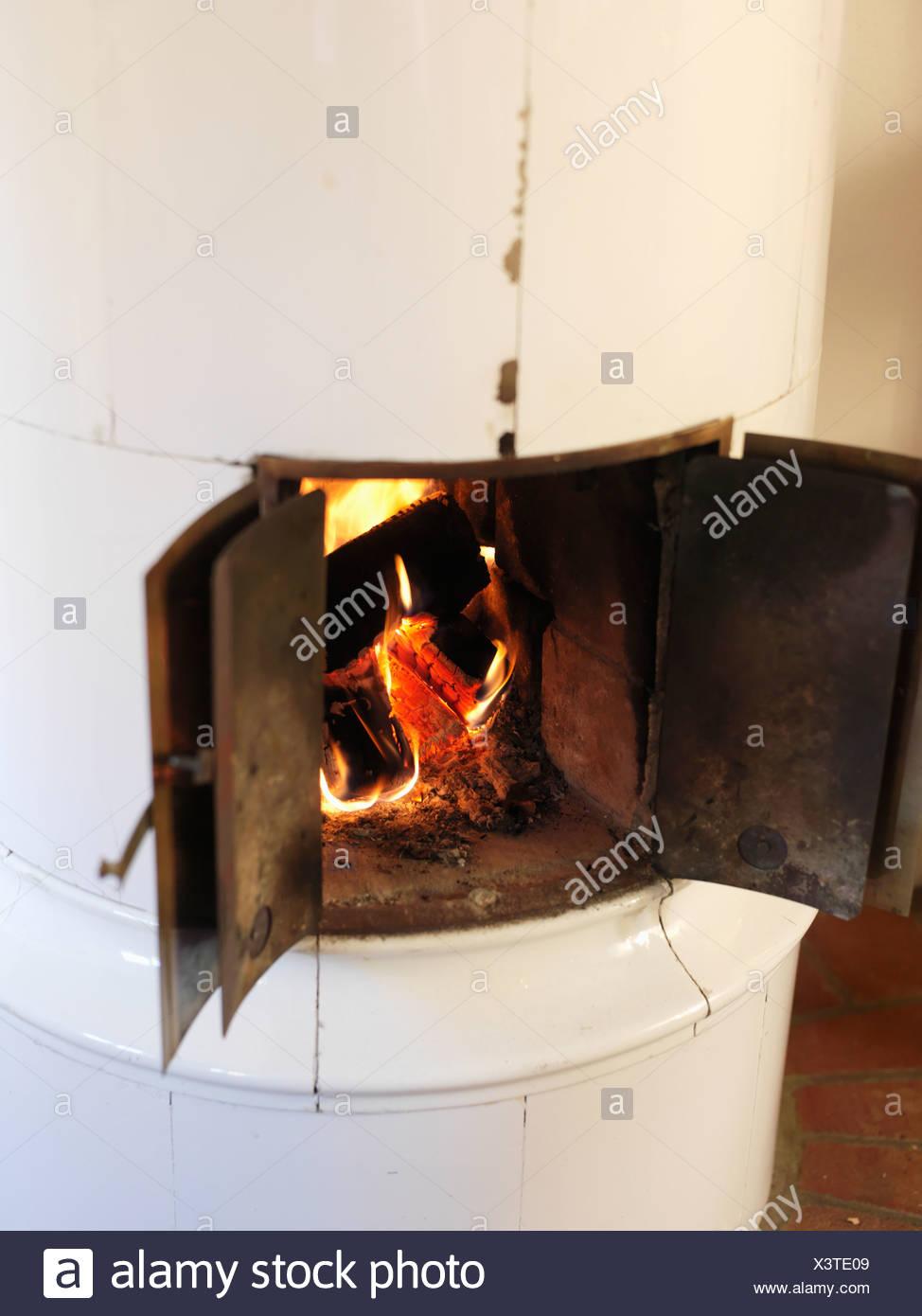 Tiled stove, Sweden. - Stock Image