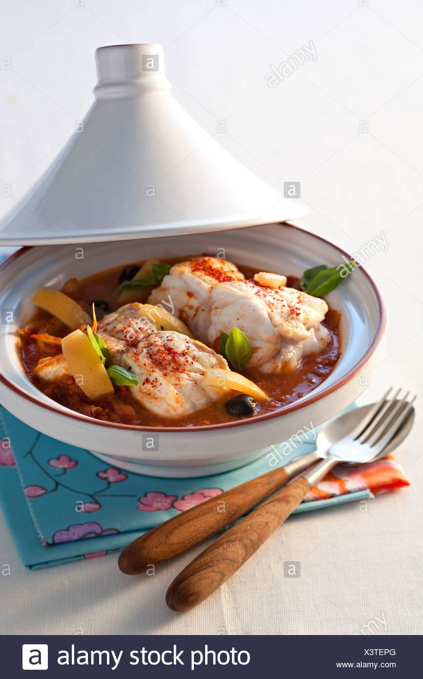 cooking Monkfish Tajine - Stock Image