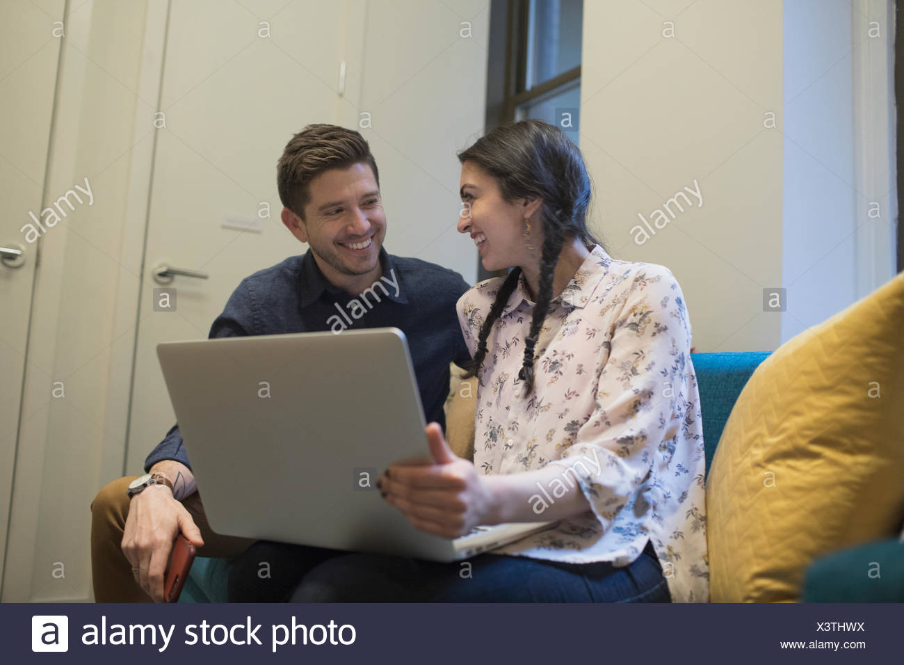Young professionals working on laptop in an office Stock Photo