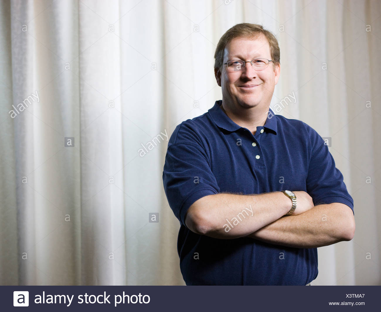 physical therapist standing with arms folded - Stock Image