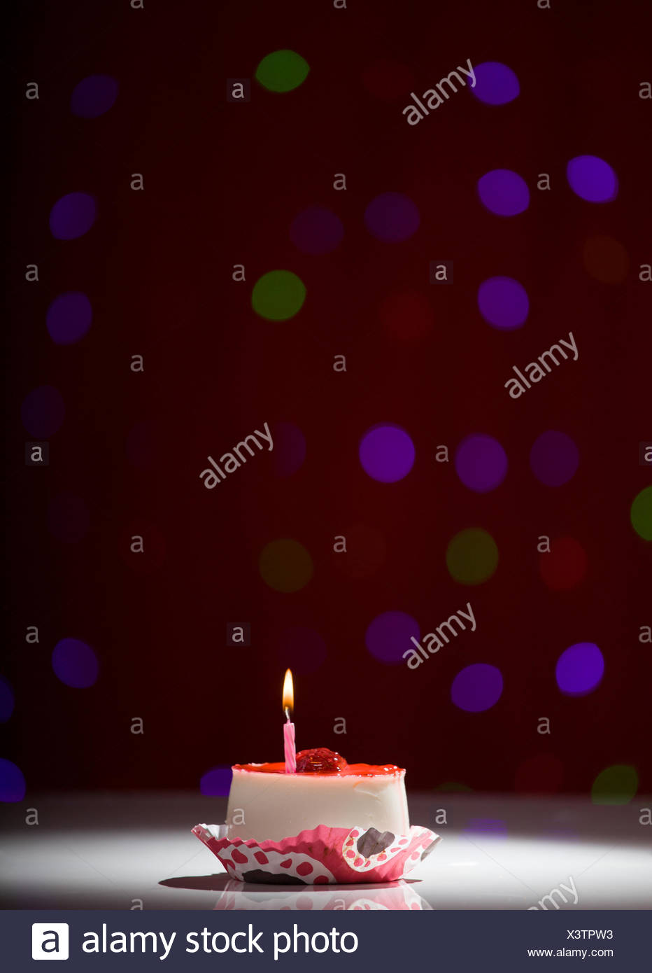 Prime Happy Birthday Cake Shot On A Red Blurred Background With Candle Funny Birthday Cards Online Fluifree Goldxyz