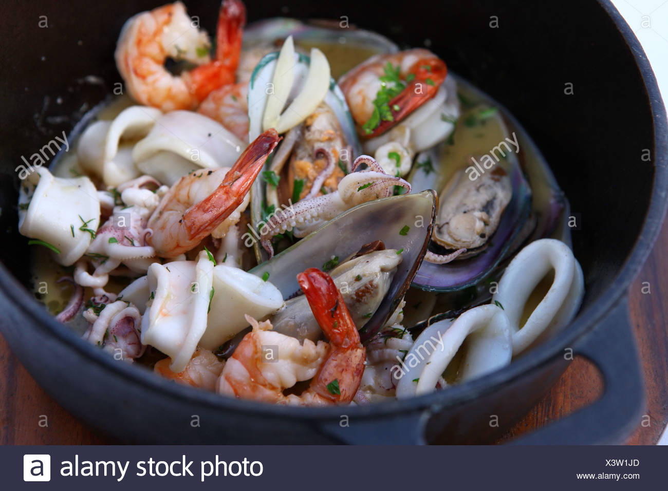 Seafood Bouillabaisse with shrimps, calamari and mussel - Stock Image