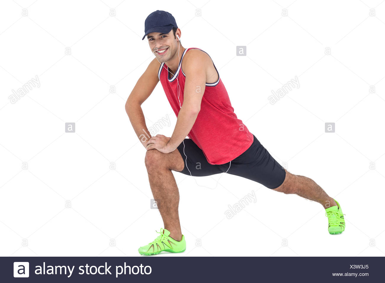 Portrait of male athlete doing stretching exercise - Stock Image
