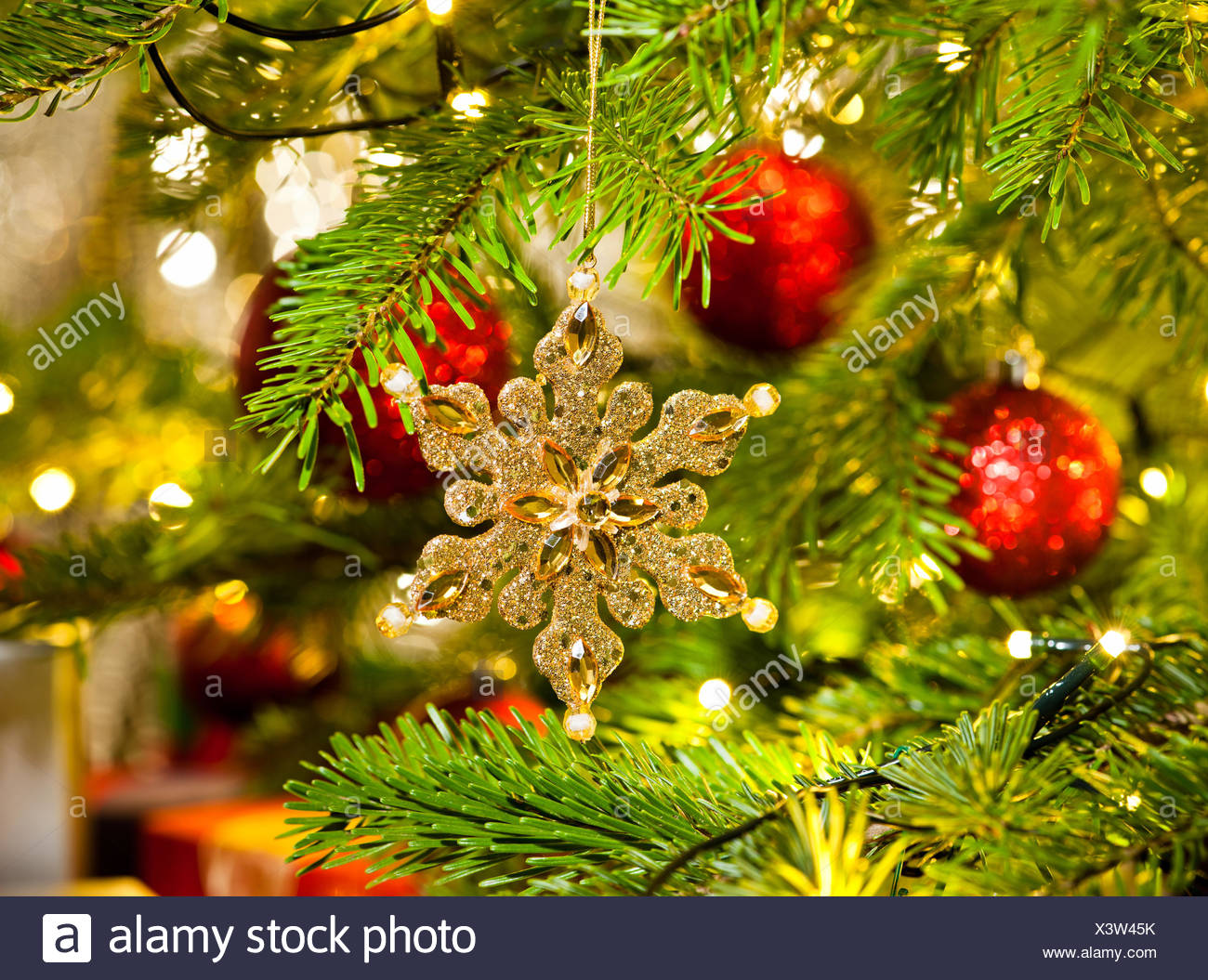 Xmas Ornament In A Real Christmas Tree In Bright Color Stock Photo Alamy