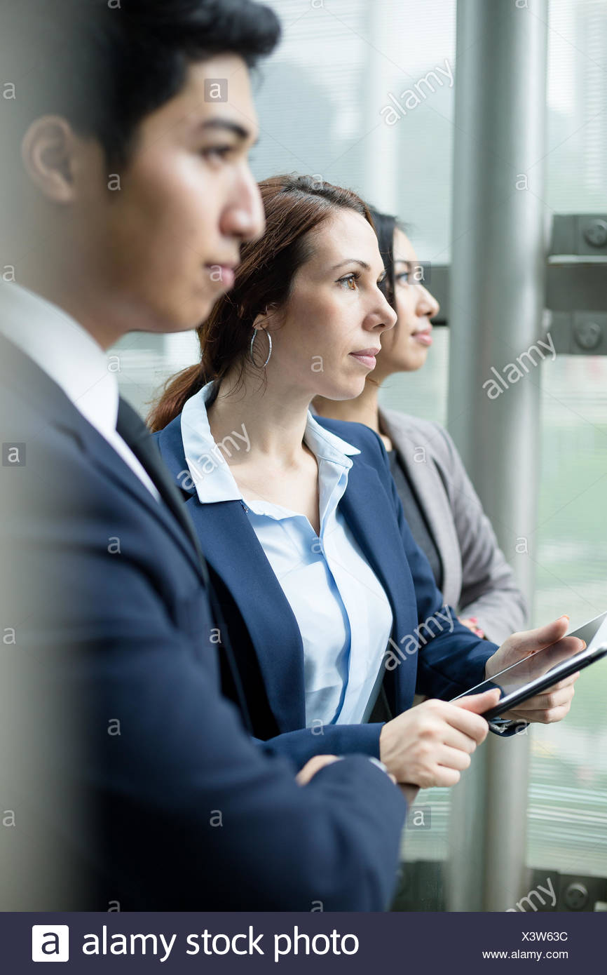 Business team inside office - Stock Image