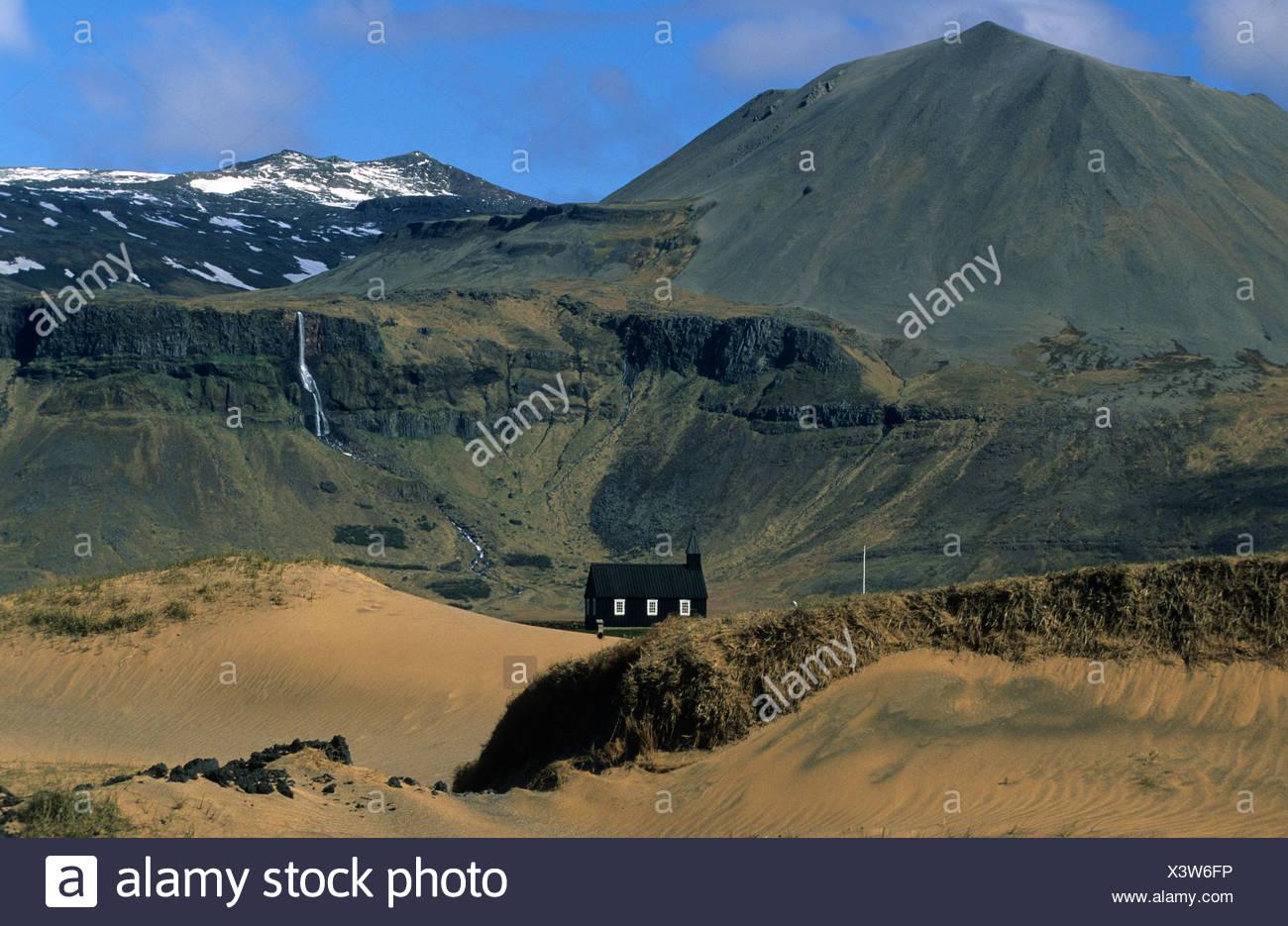Budir Iceland church mountains sand dunes waterfall landscape - Stock Image