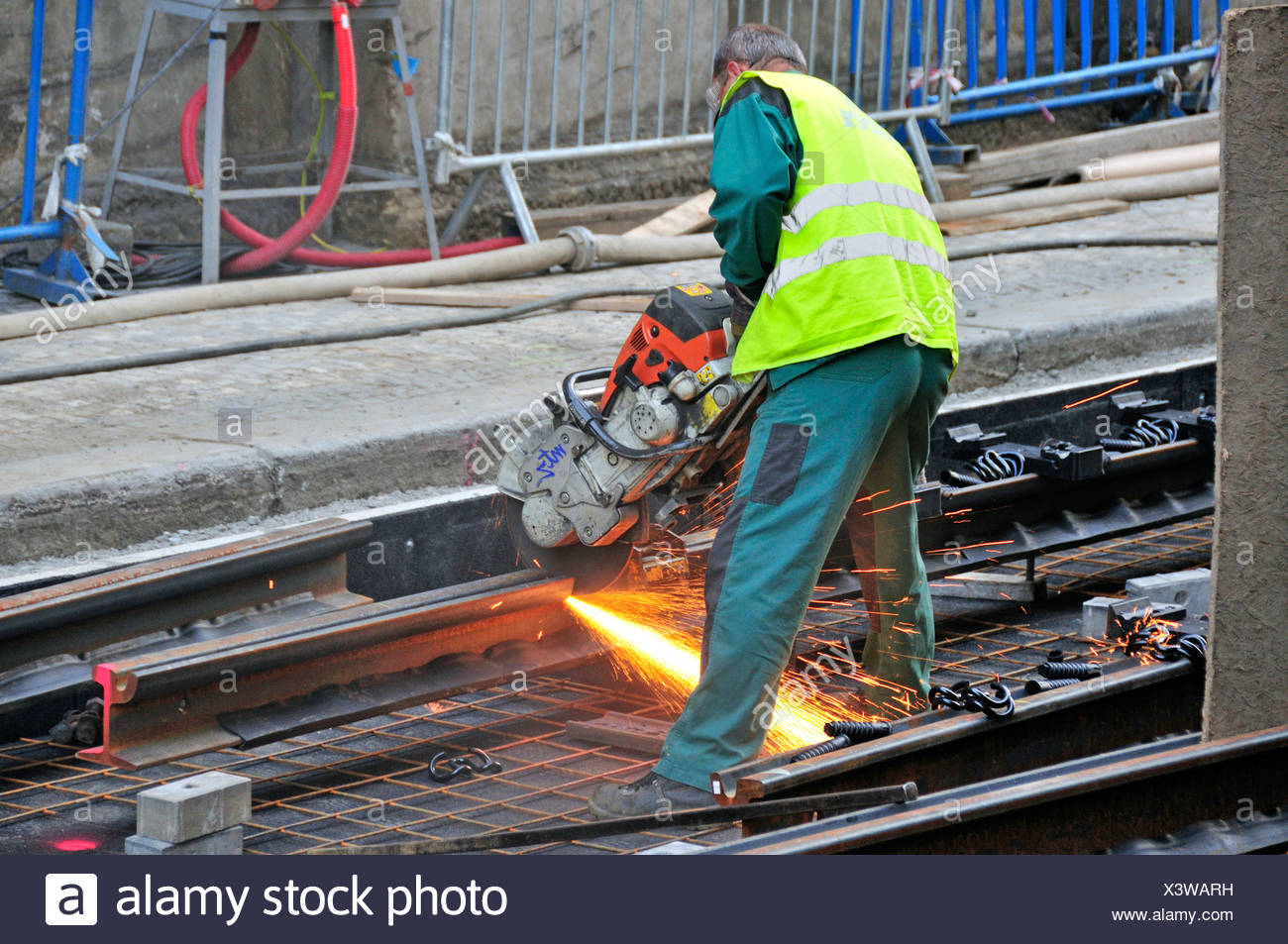 Worker with angle grinder cutting tram rails, Prague, Czech Republic, Europe, OeffentlicherGrund - Stock Image