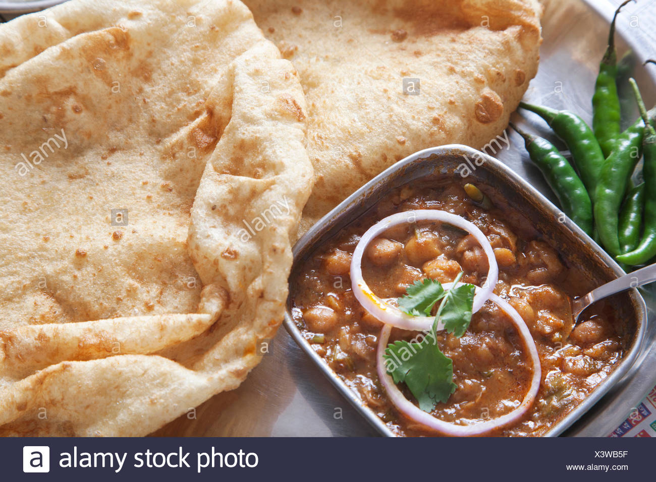 Close-up chole bhature served at table - Stock Image