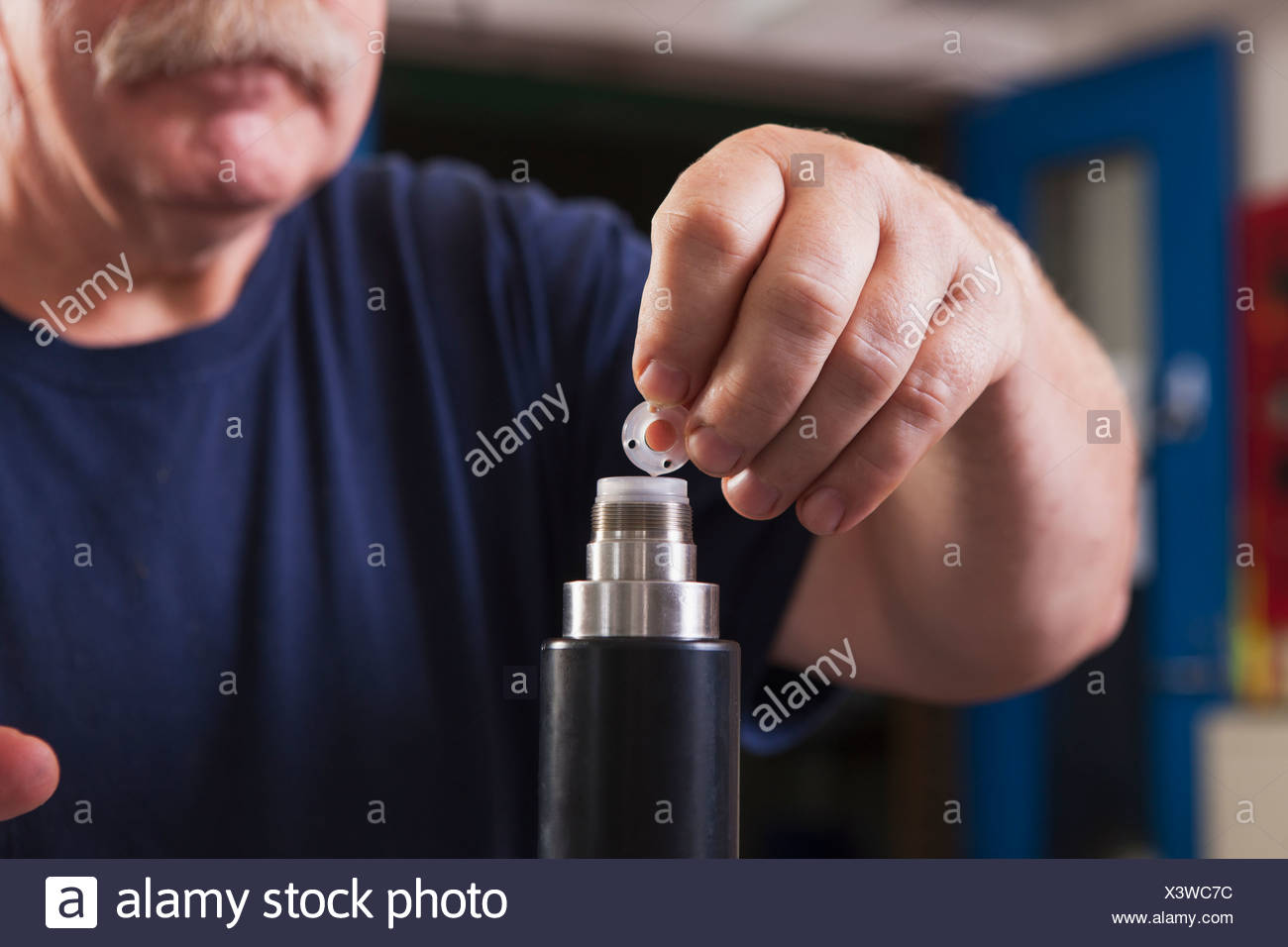 Electrochemical Stock Photos Images Alamy Integrated Circuitvintage Engineer Rebuilding An O2 Sensor Probe In A Laboratory Image