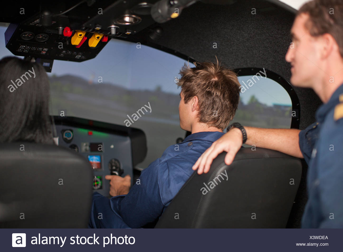 Student pilots learning to fly helicopter - Stock Image