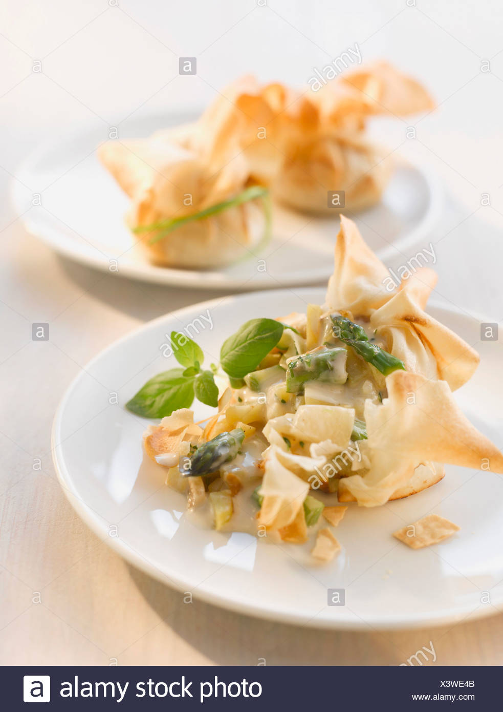 Stuffed dim sum with sweet chili sauce on plate - Stock Image