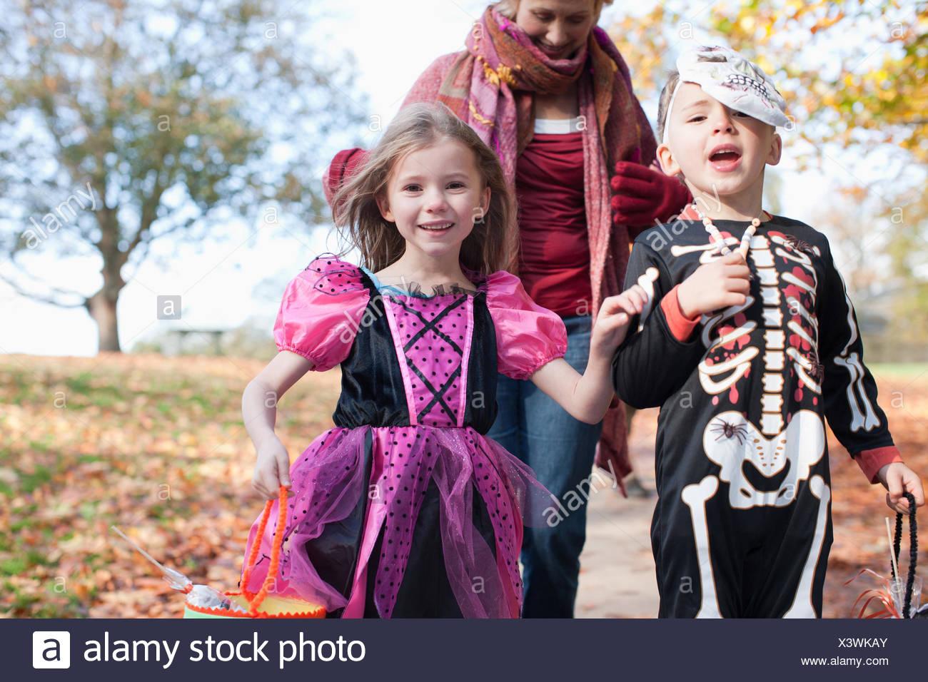 Grandmother with grandchildren in Halloween costumes - Stock Image