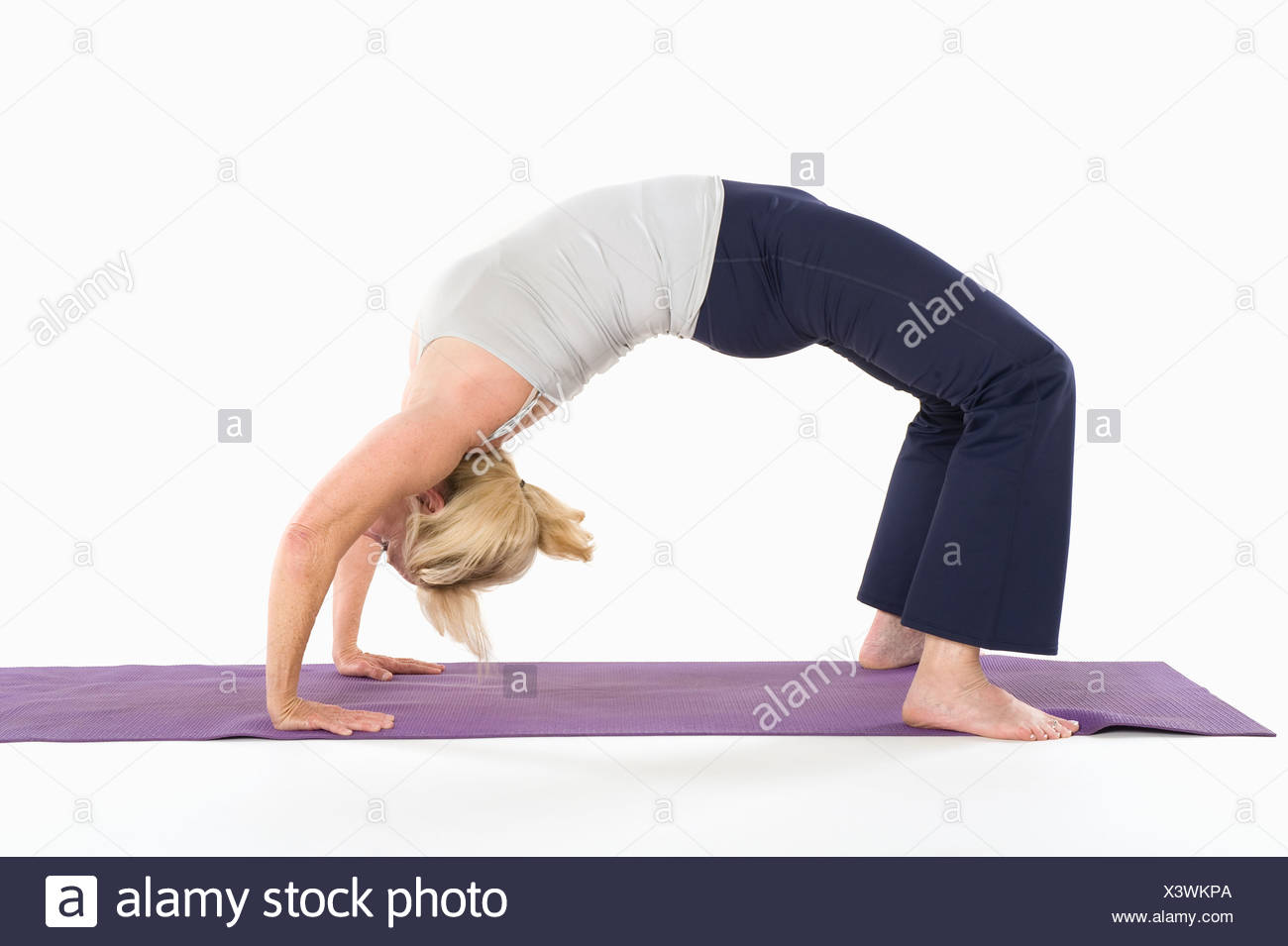 Woman In Backbend Yoga Pose Stock Photo Alamy