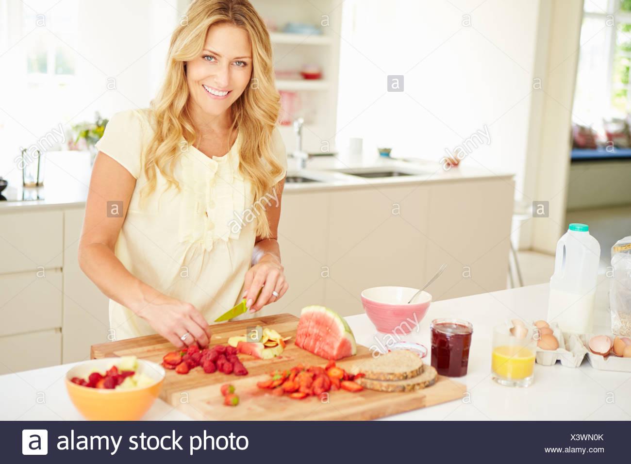 Woman Preparing Healthy Breakfast In Kitchen - Stock Image