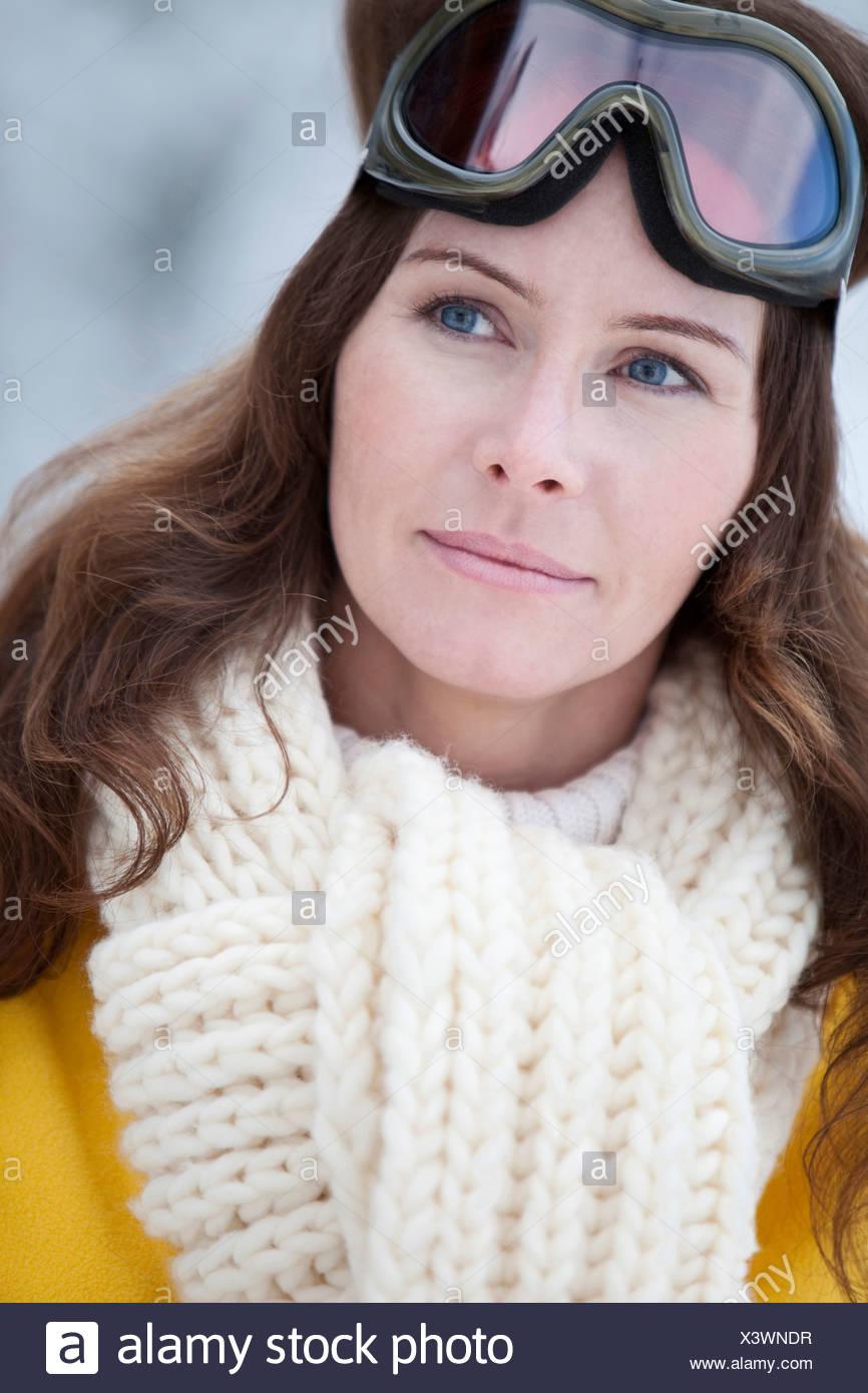 Germany, Bavaria, Woman with ski goggles, portrait - Stock Image