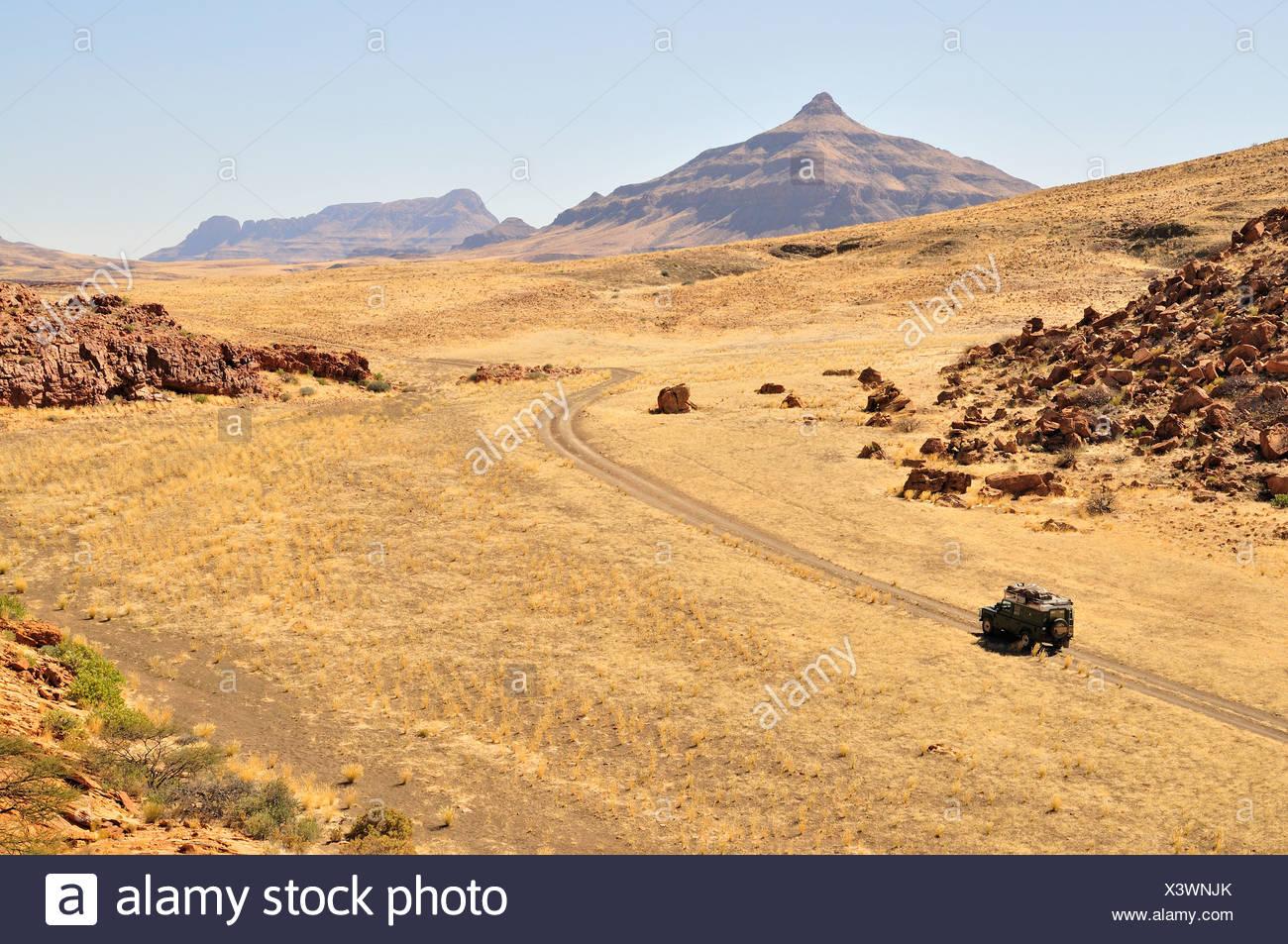 Safari vehicle in the Mik mountains, Damaraland, Namibia, Africa - Stock Image