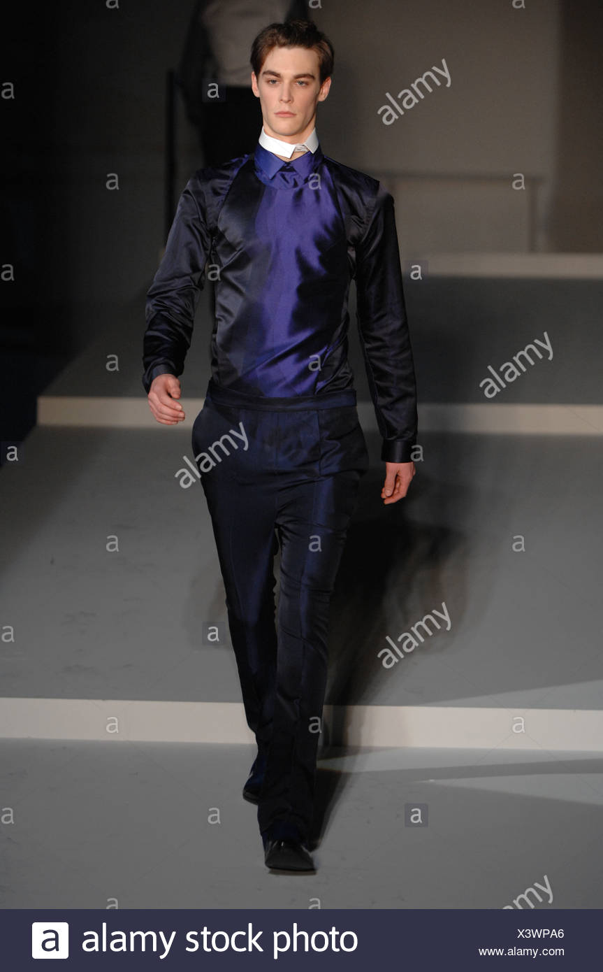 Prada Milan Ready to Wear Autumn Winter  Shiny two tone dark blue taffeta shirt and slim trousers, with detached white collar - Stock Image