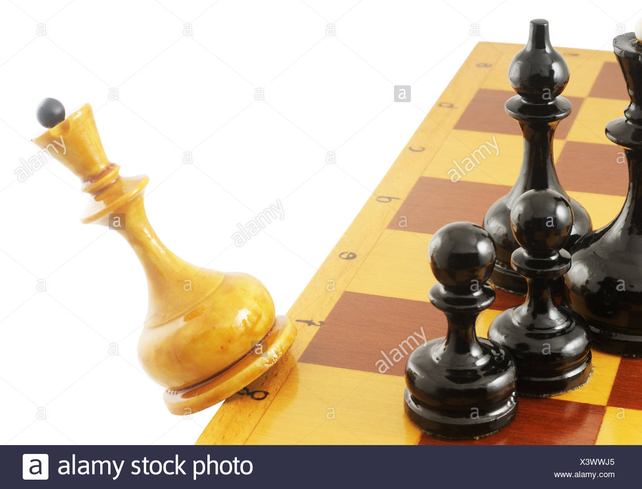 Falling white chess queen from chessboard isolated on white - Stock Image