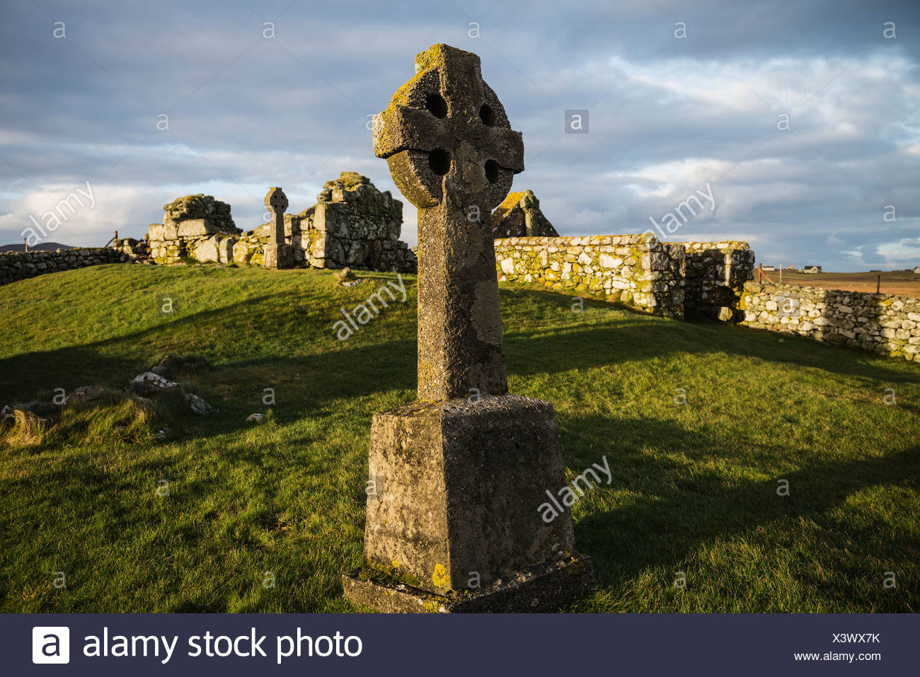 Tomb stone in cemetery, Howmore, South Uist, Outer Hebrides, Scotland - Stock Image