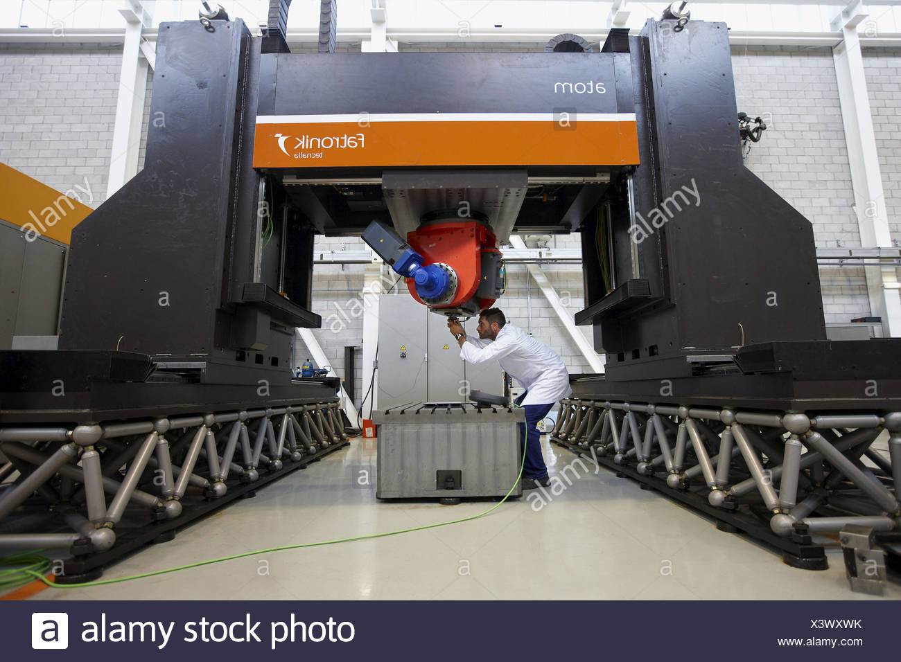 Researcher working on Atom friction stir welding machine, Fatronik-Tecnalia, Research and Technology Center, Donostia, Basque - Stock Image
