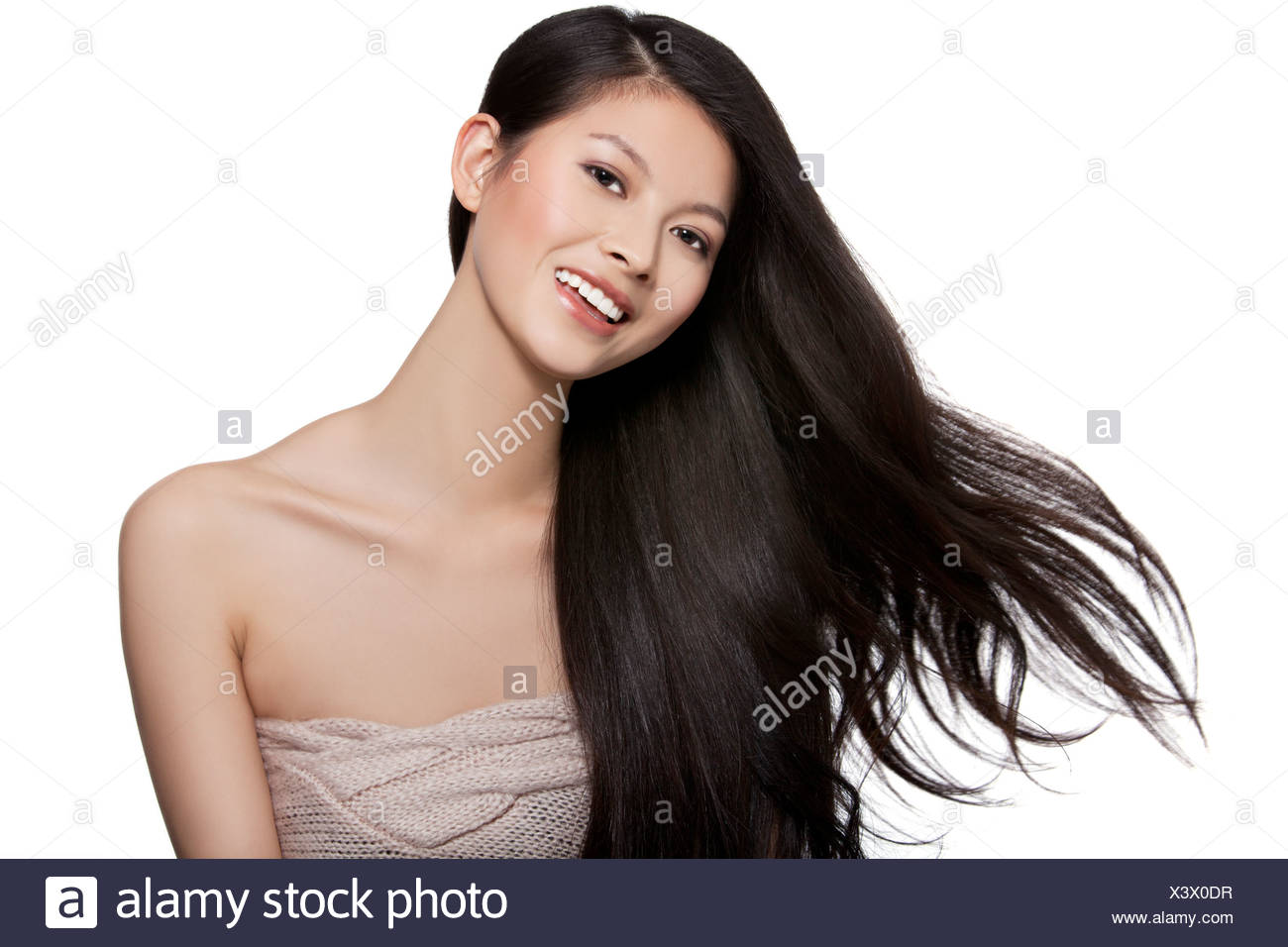 Young Woman With Long Hair Blowing in the Air - Stock Image