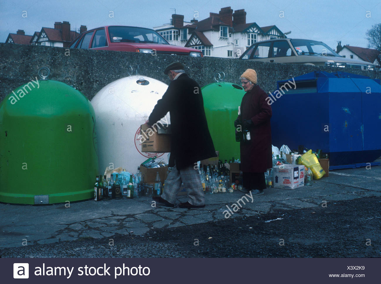Conservation Recycling Bottle banks at Colwyn Bay overflowing people with more bottles - Stock Image