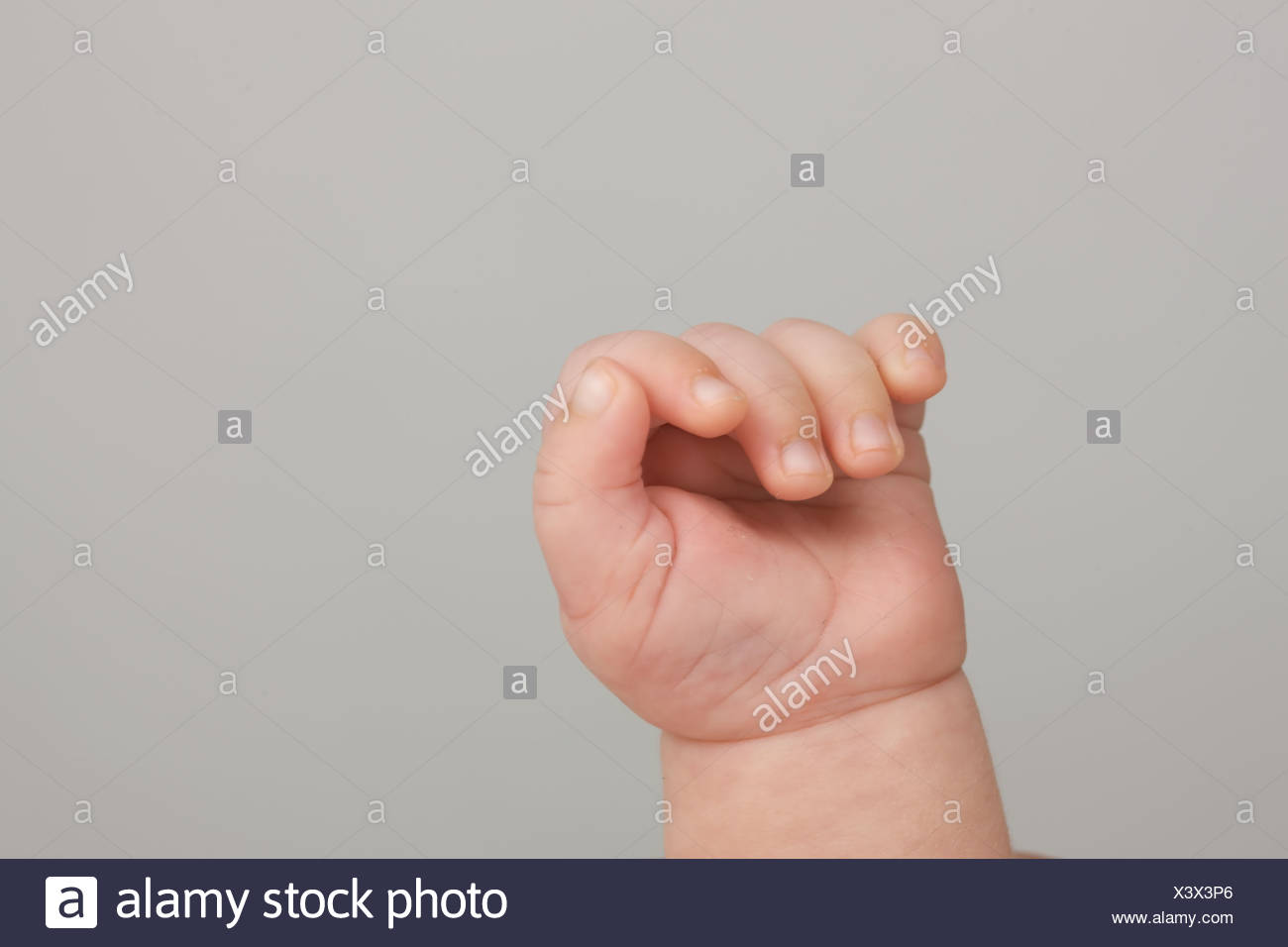 Woman's hand and Baybfinger - Stock Image