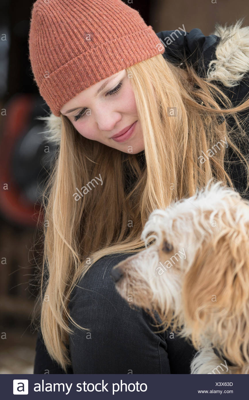 Teenage girl with her dog, Bavaria, Germany - Stock Image