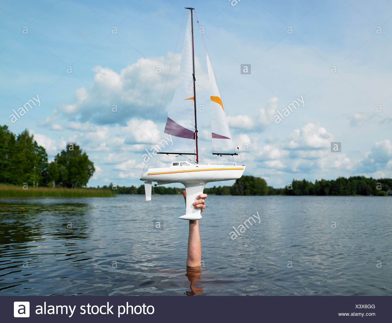 Remote-controlled boat above the water - Stock Image