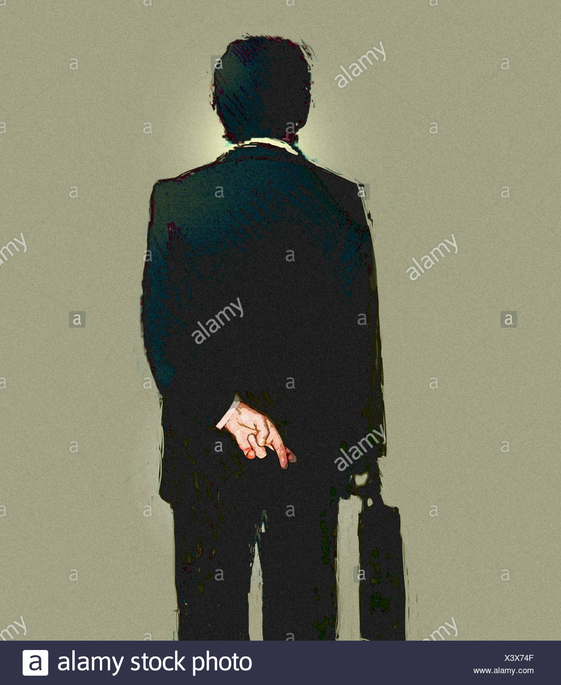 Rear view of businessman with fingers crossed - Stock Image