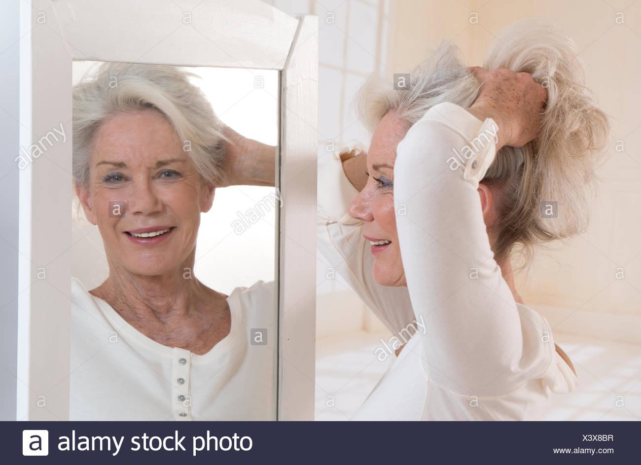 HAIR CARE, SENIOR Stock Photo