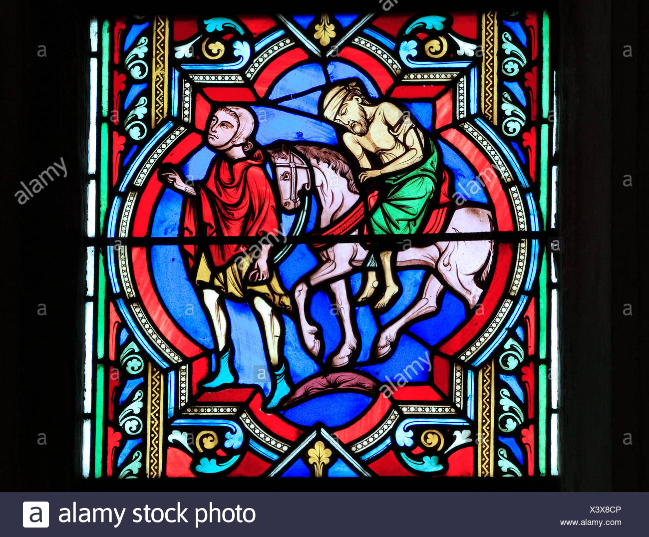 The Good Samaritan Parable,  Samaritan carries the injured traveller on his horse, by Oudinot of Paris, 1859, Feltwell, Norfolk, England, UK - Stock Image