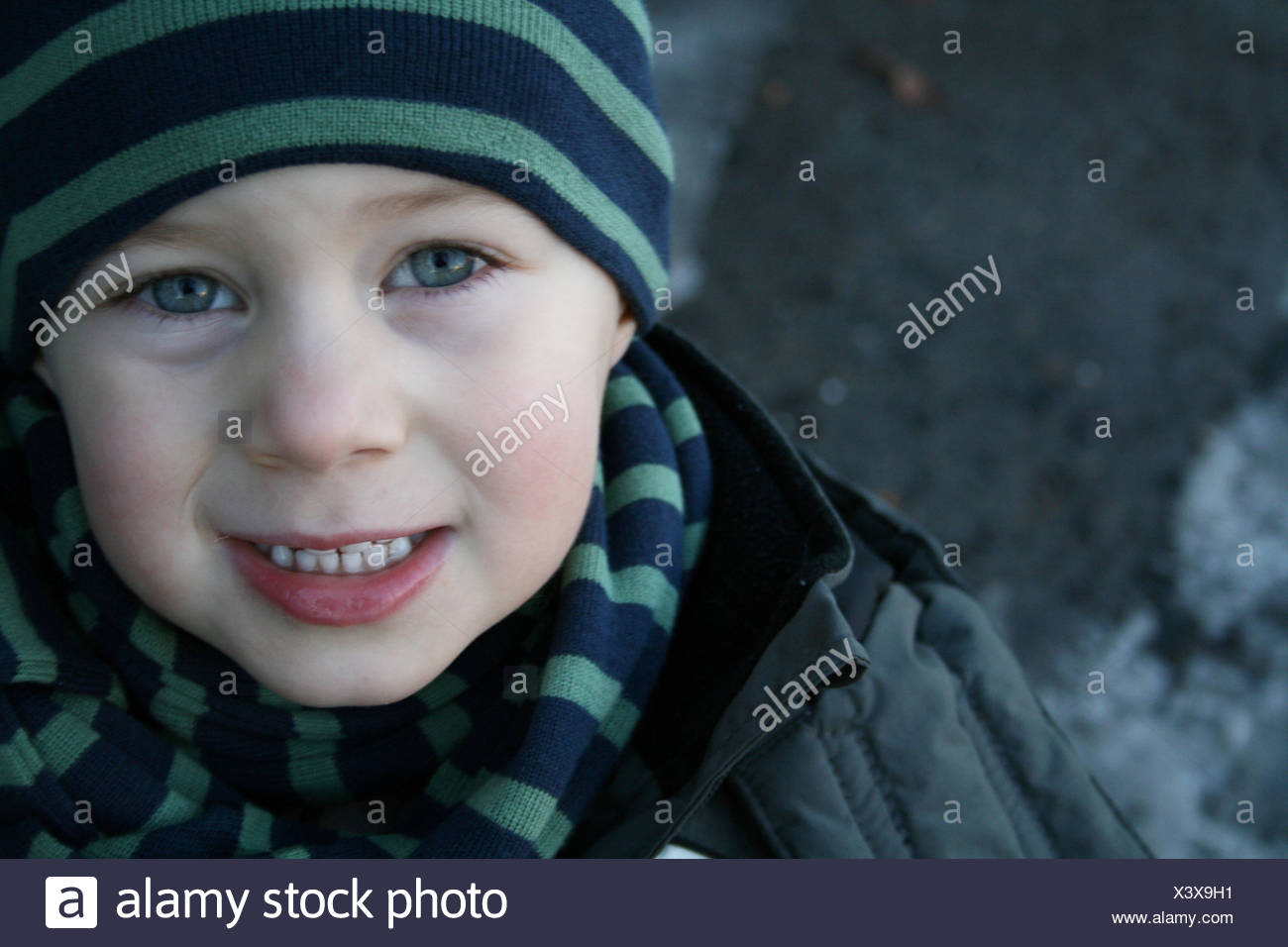mouth teeth face portrait tricky boy lad male youngster child winter mouth cold - Stock Image