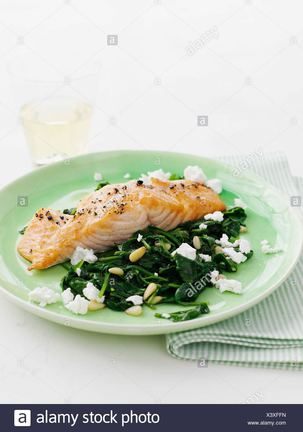 Plate of salmon with spinach - Stock Image