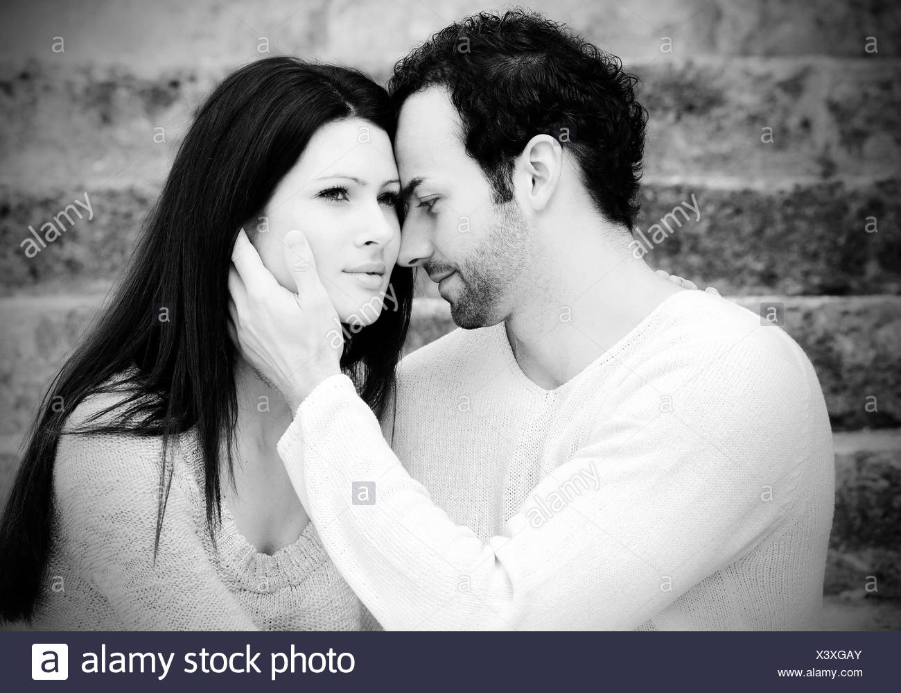 Young man holding a young womans head austria stock image