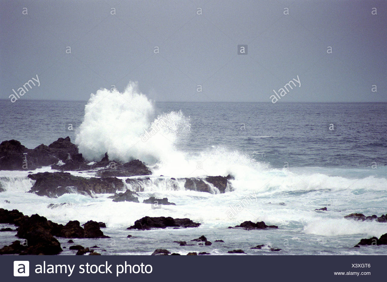 The atlantic sea breaking waves on the rocks - Stock Image