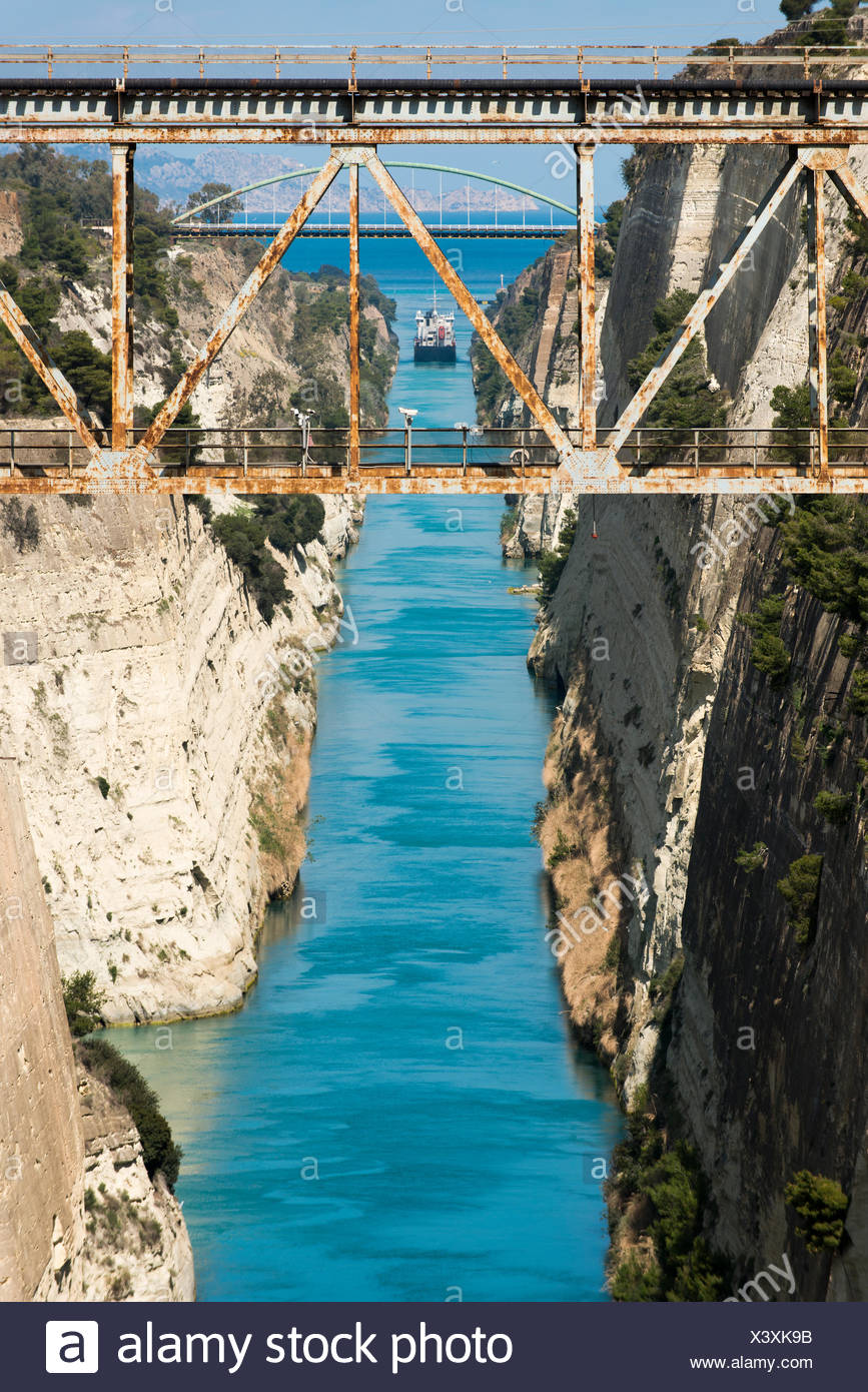 A ship in the Corinth Canal which separates the Peloponnese from the Greek mainland. - Stock Image
