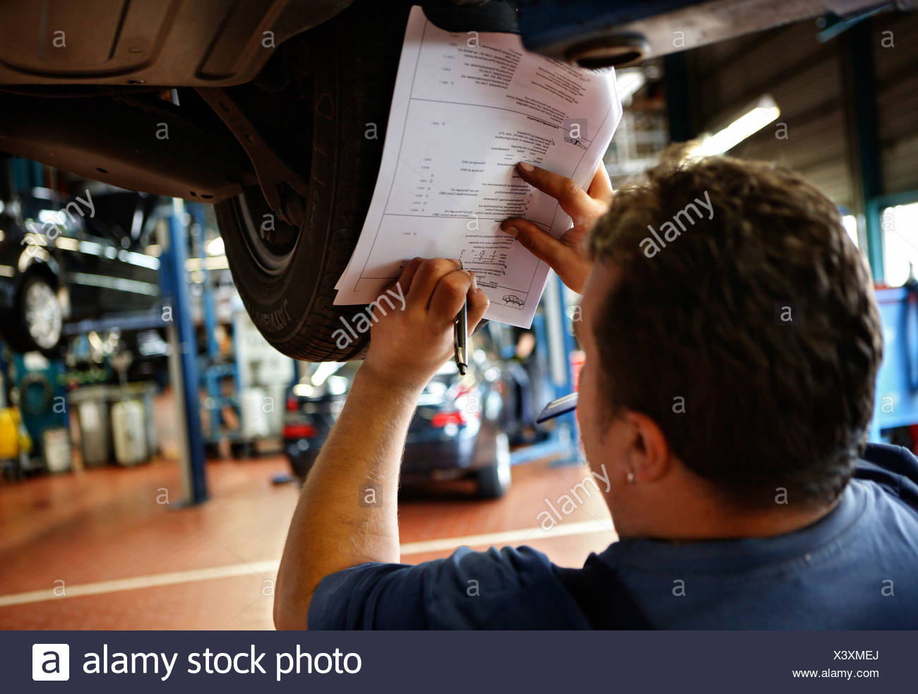Written documentation of completed work on a Mercedes E 320 in the Daimler AG, Mercedes Benz Plant in Stuttgart, Boeblingen Ser - Stock Image