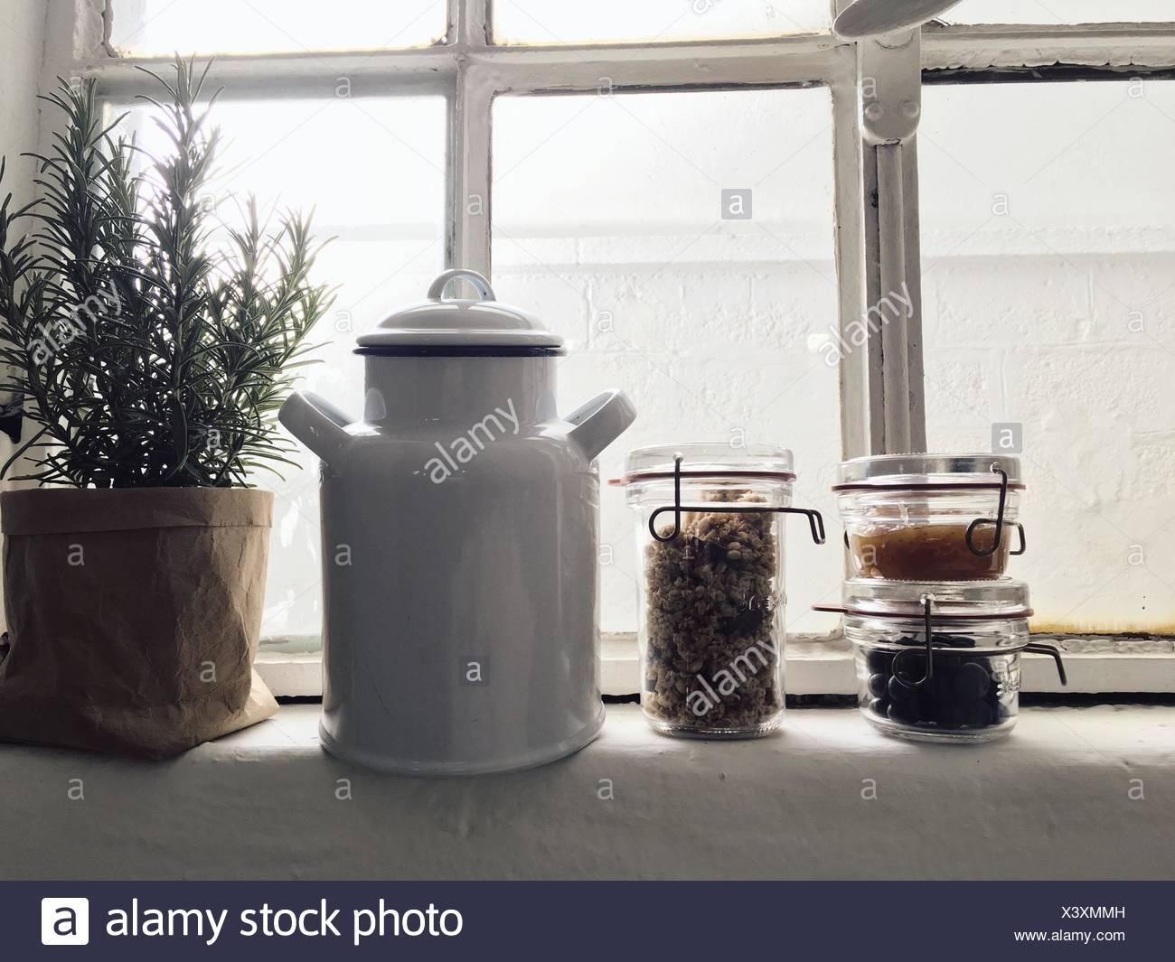 Kitchen Utensils On Window Sill - Stock Image
