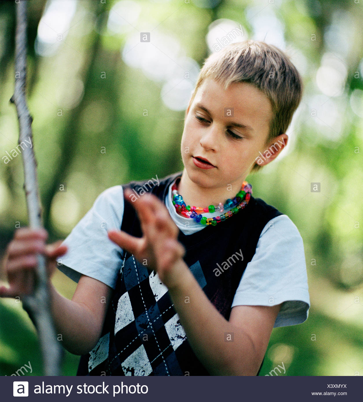 Boy playing in a forest, Sweden. - Stock Image