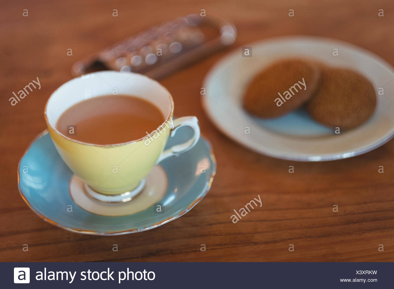 Tea with cookies on wooden table - Stock Image