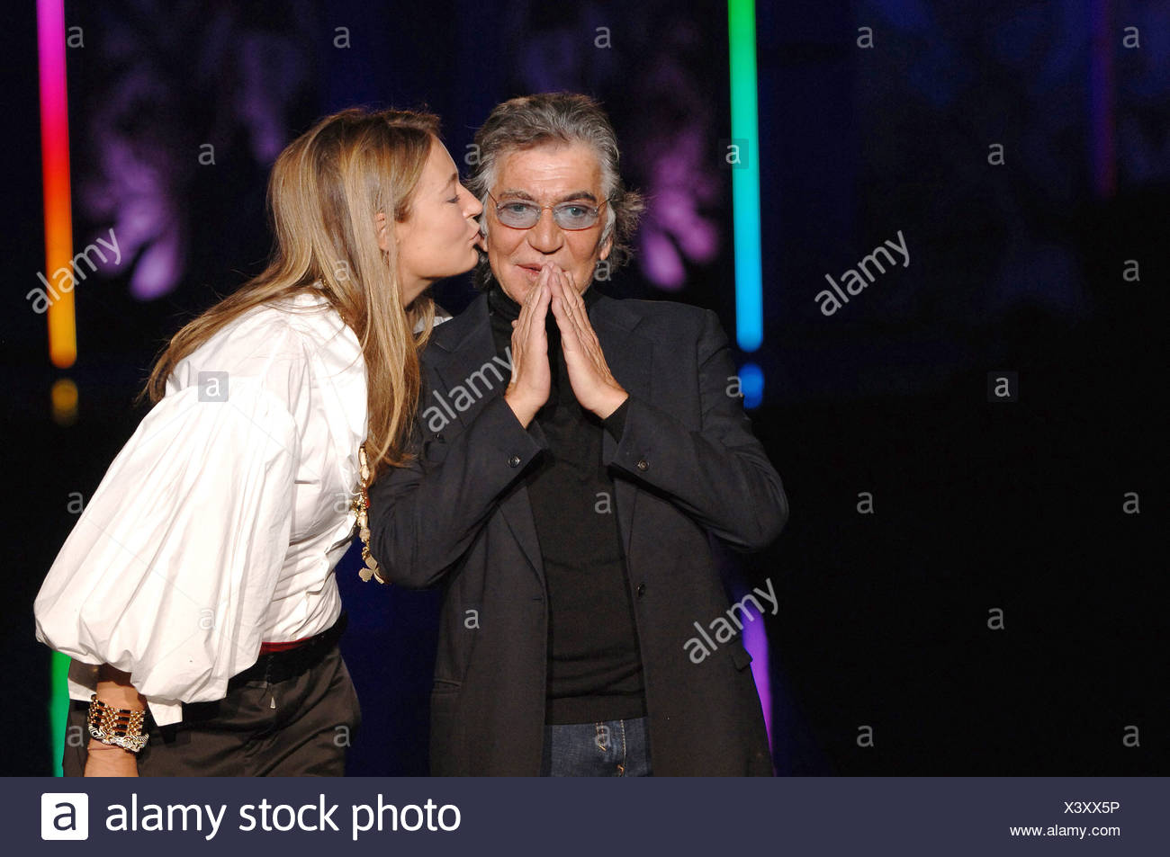 Just Cavalli Ready To Wear Milan A W Italian Fashion Designer Roberto Cavalli Recieves A Kiss From His Wife Business Partner Stock Photo Alamy