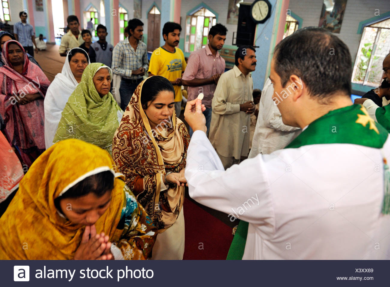 Mass, veiled women receiving Communion, Parish Church of St