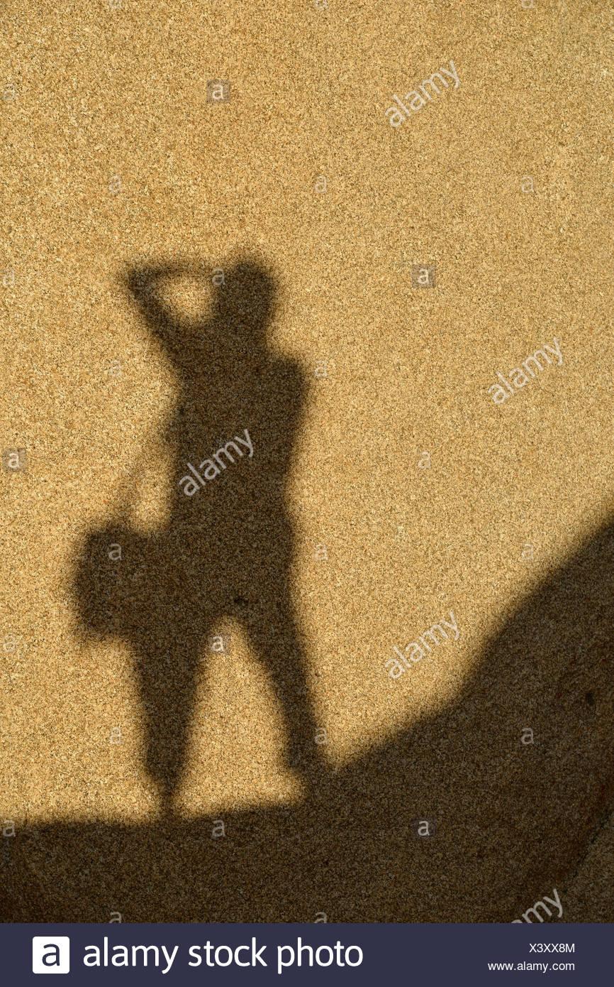 Shadow of a photographer on a monzogranite rock formation, Hidden Valley, Joshua Tree National Park, Mojave Desert, California Stock Photo