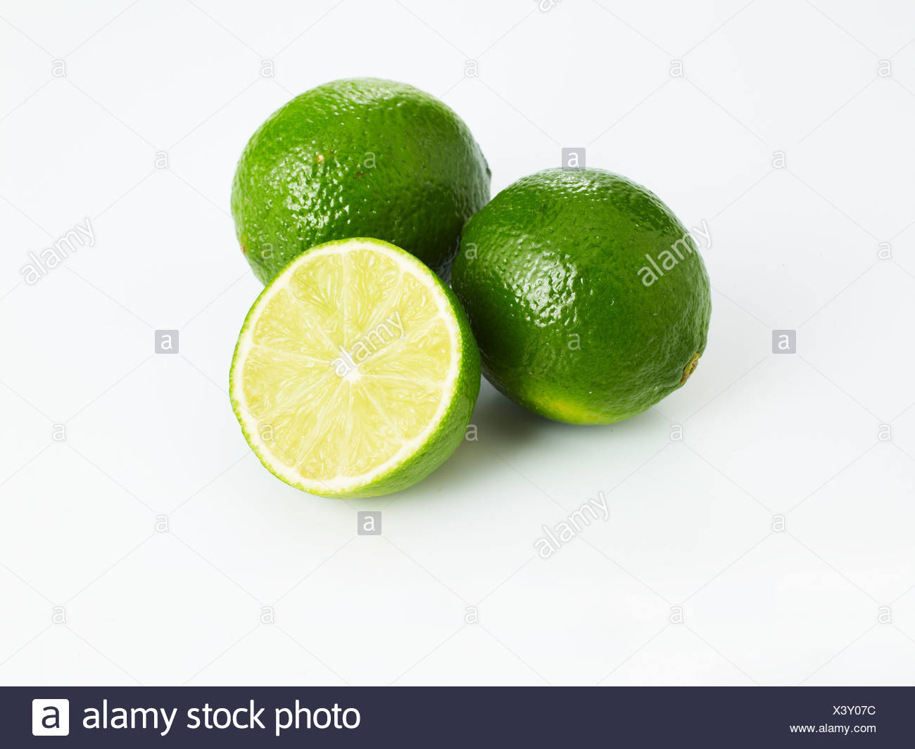 Limes on white background - Stock Image