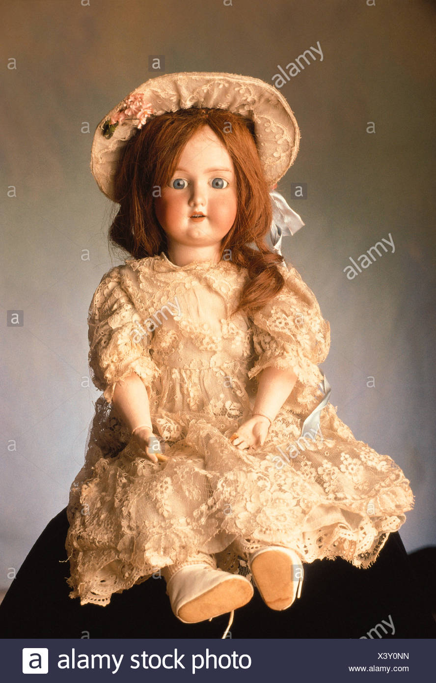 df8e685ee45 OLD FASHIONED DOLL IN LACE DRESS AND MATCHING HAT Stock Photo ...