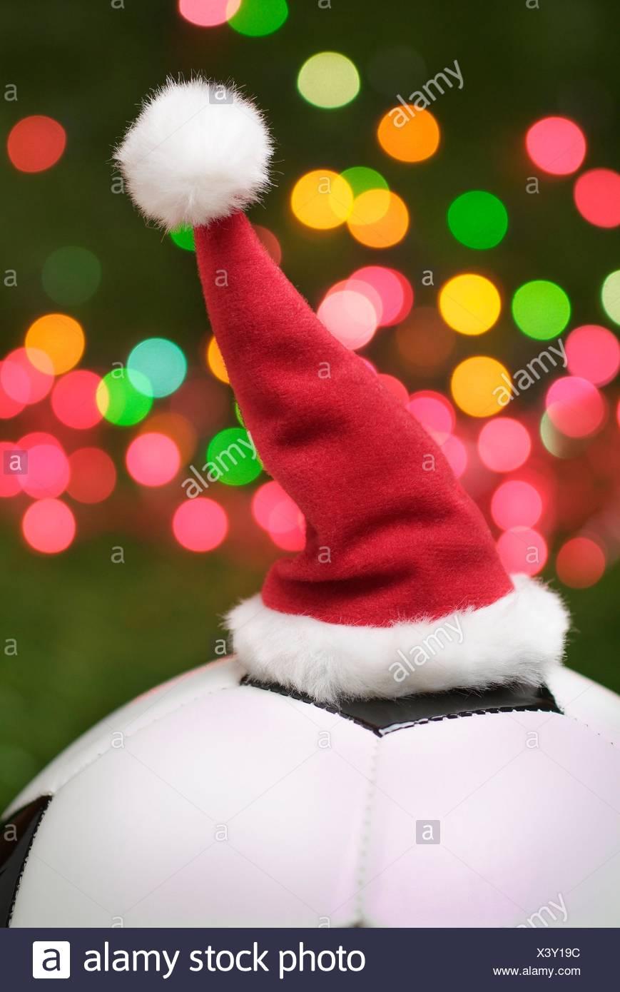 Football, Christmas Day, 2021 Santa Claus Hat On Football With Christmas Lights Stock Photo Alamy