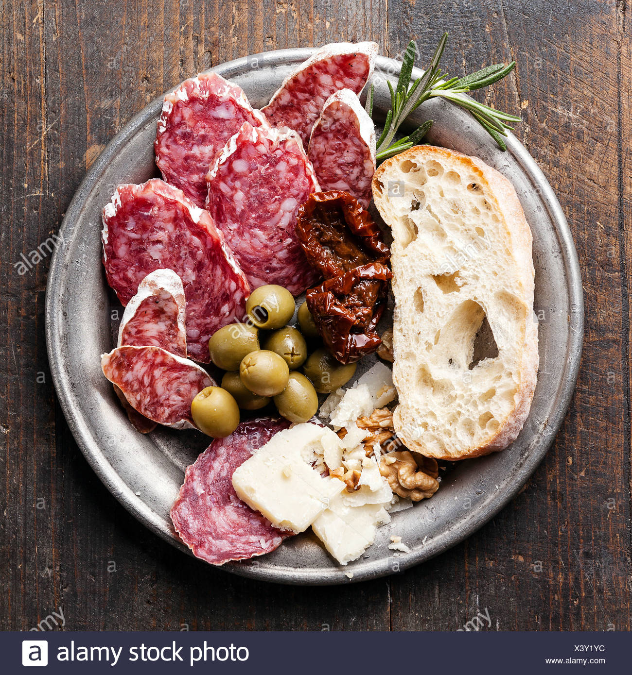 Italian salami with olives and ciabatta - Stock Image
