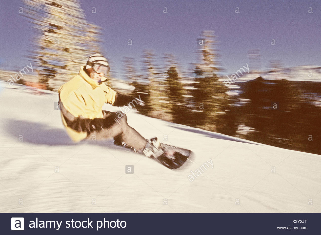An antique filtered image of a man snowboarding at Diamond Peak above Lake Tahoe in Nevada Stock Photo